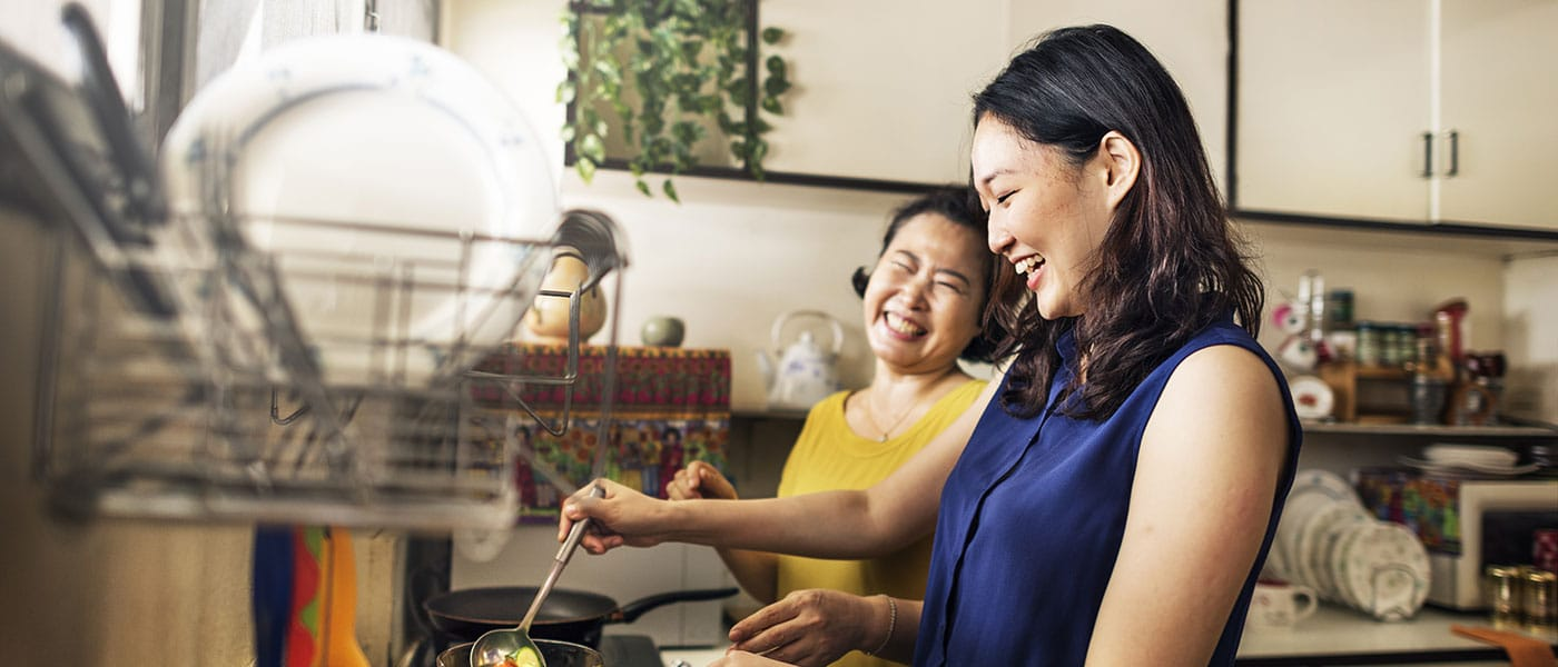 mother daughter connecting and smiling asian older mom