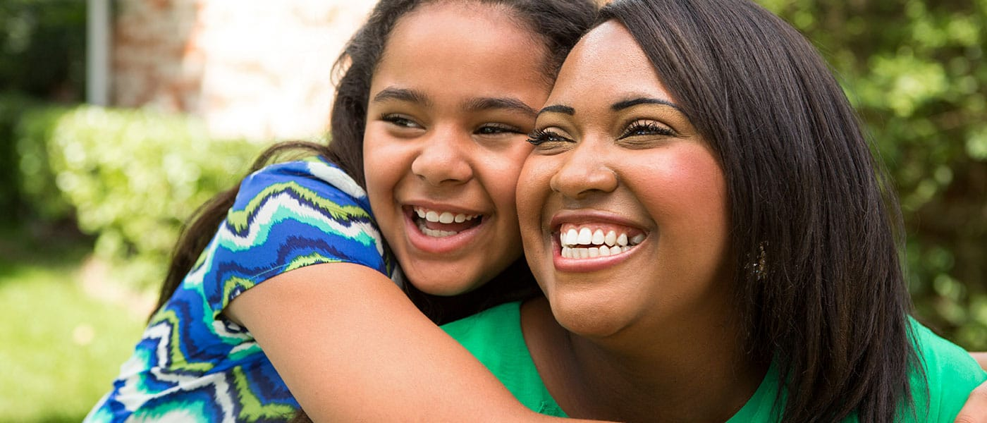 mother daughter connecting and smiling black girl
