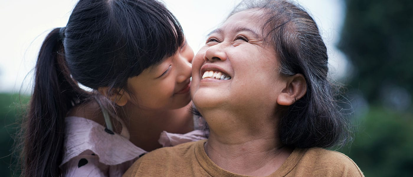mother daughter connecting and smiling asian girl