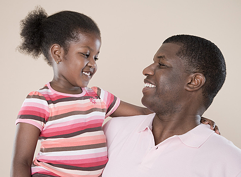 father daughter bond smiling at each other