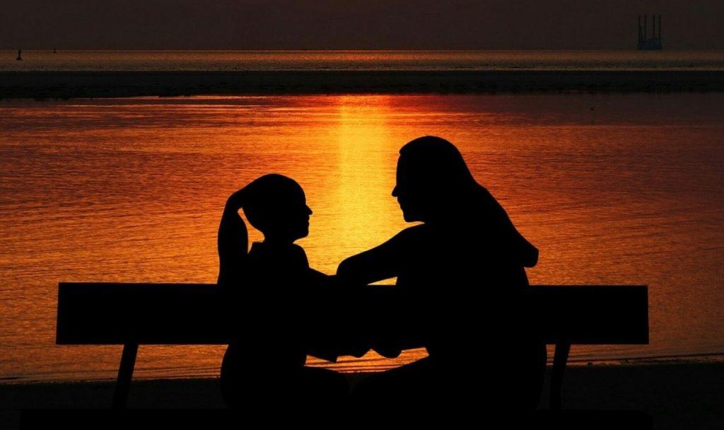 mom daughter sunset bench