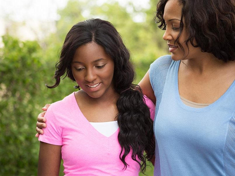 black mom and tween daughter